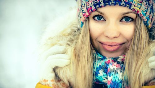 Winter Woman Face portrait happy smiling in knitting hat and scarf Fashion clothing outdoor Travel Lifestyle snow nature on background