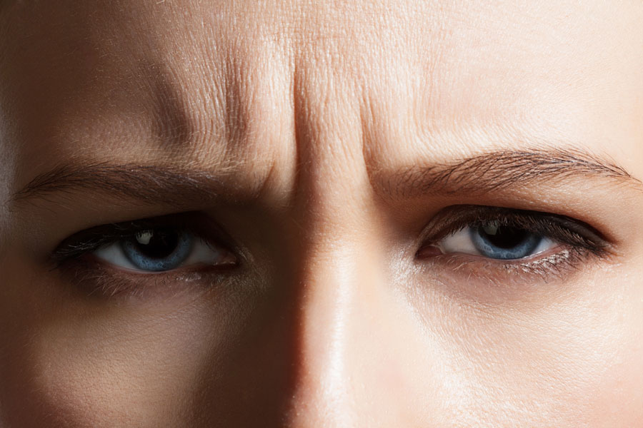 stock photo of woman's elevens or wrinkles between brows