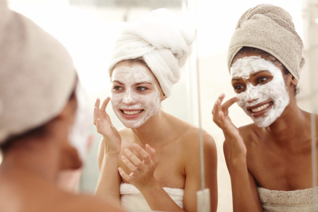 Girls doing facials together